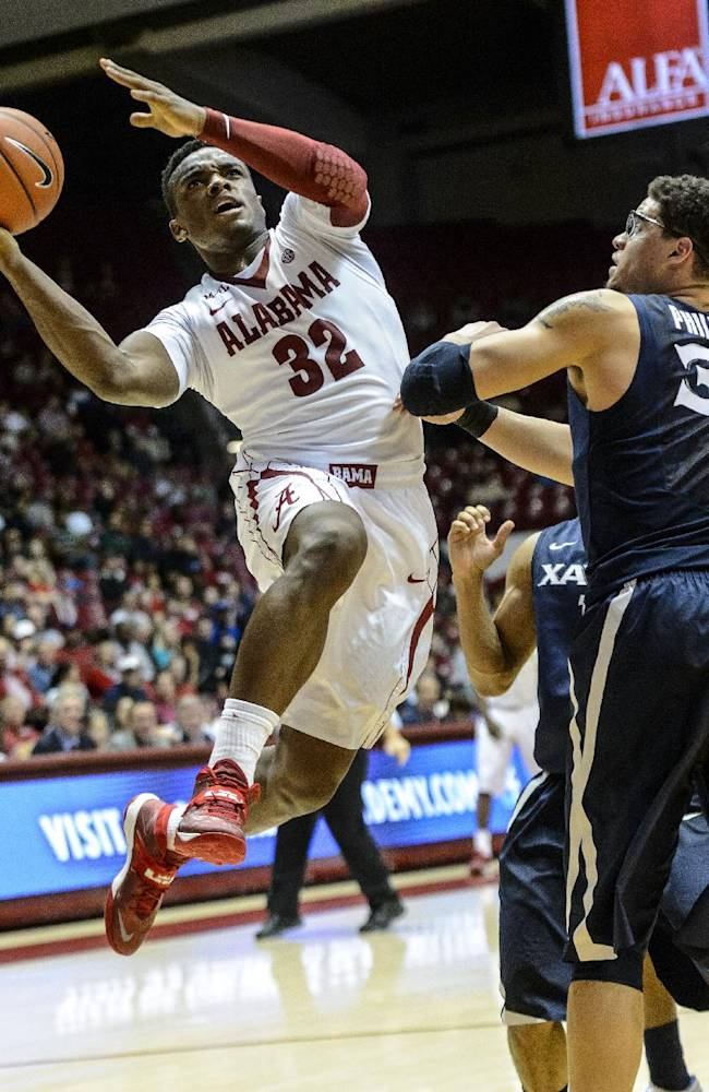 Alabama guard Retin Obasohan (32) gets inside the Xavier defense during their NCAA college basketball game at Coleman Coliseum, Saturday, Dec. 21, 2013, in Tuscaloosa, Ala