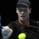 Czech Republic's Tomas Berdych plays a return to Serbia's Novak Djokovic, during their singles ATP World Tour Finals tennis match at the O2 Arena in London, Friday, Nov. 14, 2014. (AP Photo/Kirsty Wigglesworth)