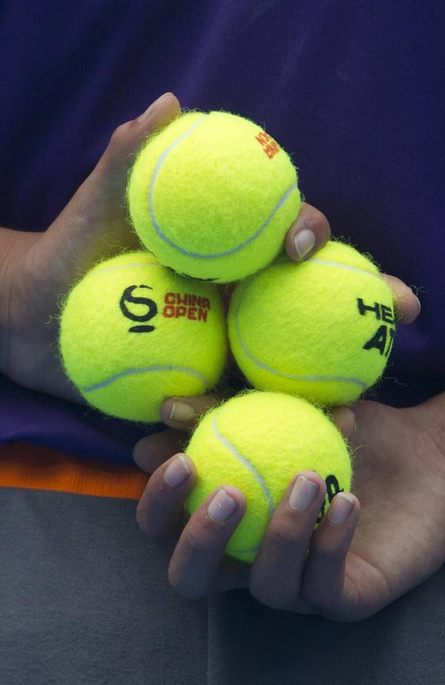 A ball boy holds tennis balls before the semifinal match between Rafael Nadal of Spain and Tomas Berdych of the Czech Republic at the China Open tennis tournament at the National Tennis Stadium in Beijing, China Saturday, Oct. 5, 2013