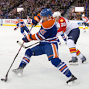 Florida Panthers' Sean Bergenheim (20) chases Edmonton Oilers' Andrew Ference (21) during first-period NHL hockey game action in Edmonton, Alberta, Sunday, Jan. 11, 2015 The Associated Press