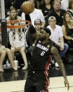 Miami Heat's LeBron James (6) dunks against the San Antonio Spurs during the first half at Game 5 of the NBA Finals basketball series, Sunday, June 16, 2013, in San Antonio. (AP Photo/David J. Phillip)
