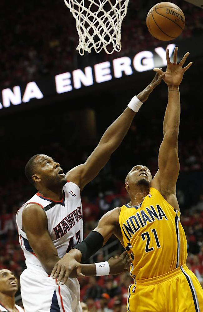 Indiana Pacers forward David West (21) shoots as Atlanta Hawks forward Elton Brand (42) defends in the first half of Game 6 of a first-round NBA basketball playoff series in Atlanta, Thursday, May 1, 2014
