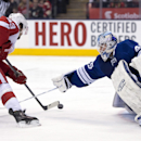 Detroit Red Wings center Darren Helm (43) completes his hat trick with a goal past Toronto Maple Leafs goaltender Jonathan Bernier during third-period NHL hockey game action in Toronto, Saturday, March 29, 2014 The Associated Press