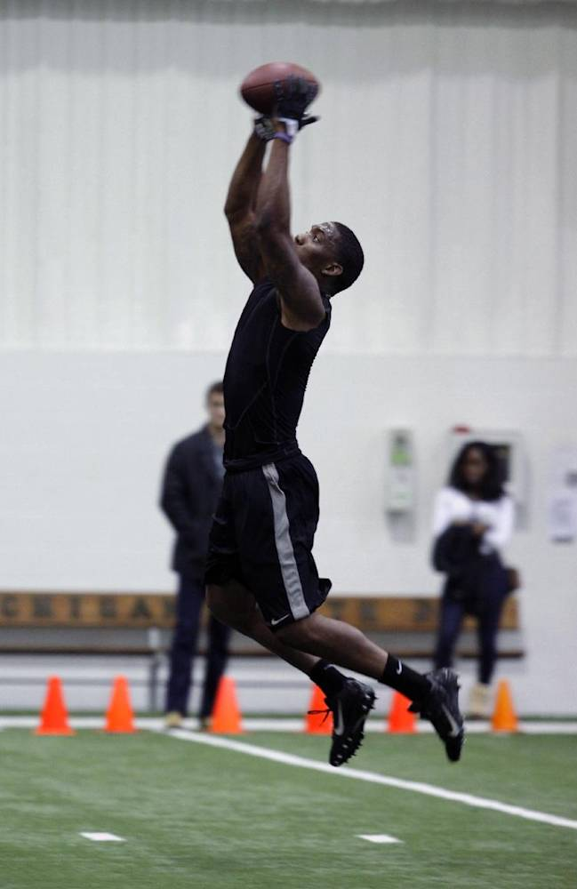 Former Michigan State cornerback Darqueze Dennard runs a drill during pro day for NFL scouts, Tuesday, March 11, 2014, in East Lansing, Mich