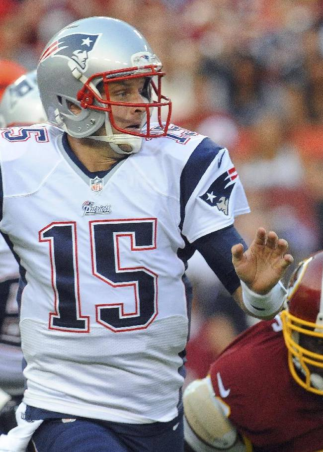 New England Patriots quarterback Ryan Mallett winds up to throw as Washington Redskins defensive end Jarvis Jenkins closes in during the first half of an NFL football preseason game in Landover, Md., Thursday, Aug. 7, 2014