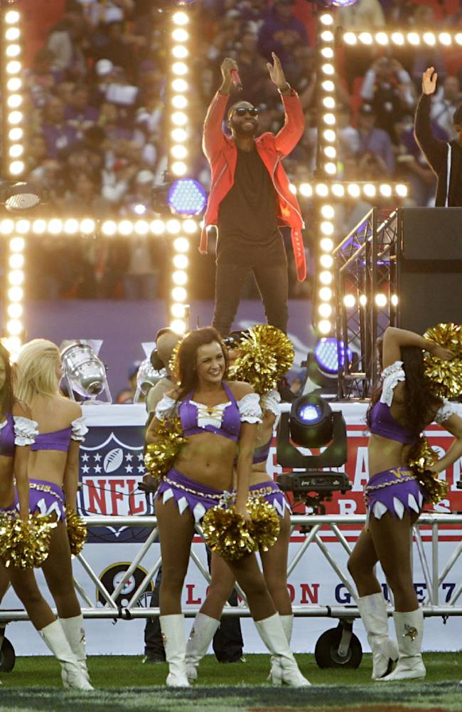 Tinie Tempah, above centre, and the Minnesota Vikings cheerleaders perform prior to the NFL International Series match between the Minnesota Vikings and the Pittsburgh Steelers at Wembley Stadium, London, Sunday, Sept. 29, 2013