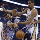 Oklahoma City Thunder guard Thabo Sefolosha (25) goes for a loose ball against New Orleans Pelicans center Alexis Ajinca in the first half of an NBA basketball game in New Orleans, Monday, April 14, 2014 The Associated Press