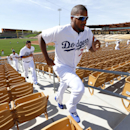 Los Angeles Dodgers pitcher Kenley Jansen leads a group running stairs during spring training baseball practice in Glendale, Ariz., Friday, Feb. 14, 2014 The Associated Press