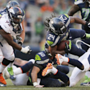 Seattle Seahawks running back Marshawn Lynch (24) drives as he carries the ball against the Denver Broncos in the second half of an NFL football game, Sunday, Sept. 21, 2014, in Seattle. The Seahawks won 26-20 in overtime The Associated Press