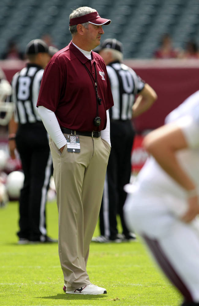 In this photo taken on Sept. 14, 2013, and provided by Fordham University,  Fordham coach Joe Moorhead watches his team warm up for a college football game against Temple in Philadelphia. The Rams are 7-0 for the first time since 1930