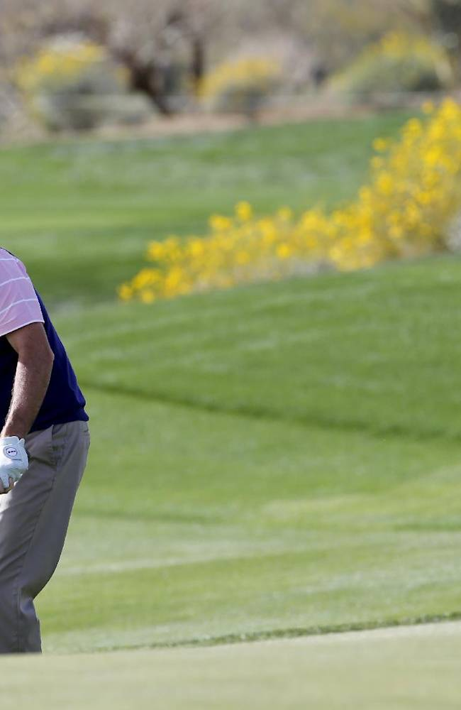 Gonzalo Fenz-Castano, of Spain, hits a chip shot on the 15th hole in his match against Hunter Mahan during the first round of the Match Play Championship golf tournament on Wednesday, Feb. 19, 2014, in Marana, Ariz