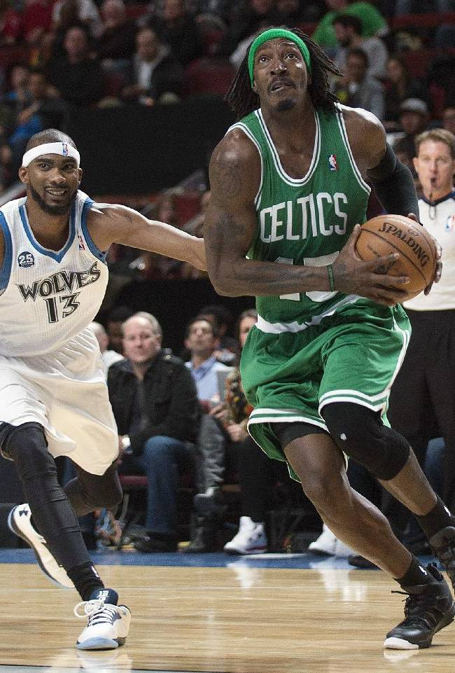 Boston Celtics' Gerald Wallace, right, drives to the net as Minnesota Timberwolves' Corey Brewer defends during first quarter of an NBA preseason basketball game in Montreal, Sunday, Oct. 20, 2013