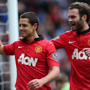 Manchester United's Javier Hernandez, left, celebrates his goal with teammate Juan Mata during their English Premier League soccer match against Newcastle United at St James' Park, Newcastle, England, Saturday, April 5, 2014