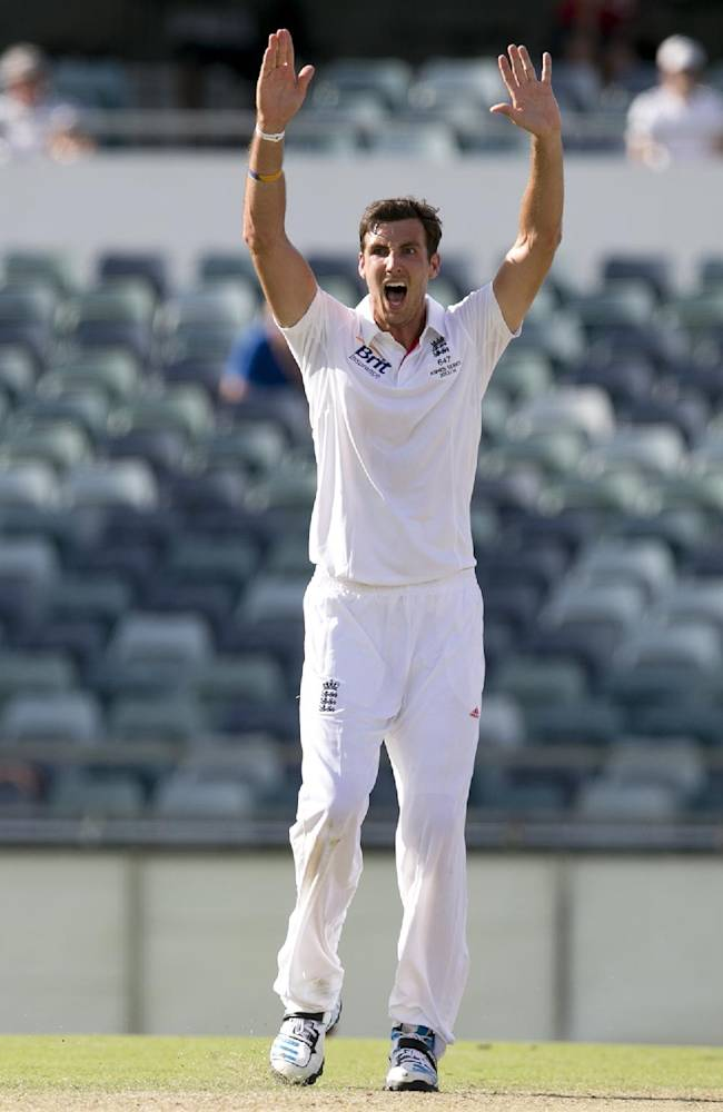 England's Steven Finn appeals to the umpire in the 2nd innings on day 3 of their tour cricket match against Western Australia Chairman's XI in Perth, Australia, Saturday, Nov. 2, 2013