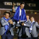Team Europe captain Jose Maria Olazabal (C) of Spain is lifted up by golfers Lee Westwood (L) and Graeme McDowell (R) after the closing ceremony of the 39th Ryder Cup at the Medinah Country Club in Medinah, Illinois, September 30, 2012. REUTERS/Mike Blake
