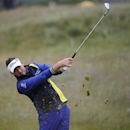 Ian Poulter of England hits from the rough on the 14th hole during a practice round ahead of the British Open golf championship on the Old Course in St. Andrews, Scotland, July 15, 2015.   REUTERS/Paul Childs