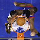 Utah Jazz's Derrick Favors, left, goes up for a dunk against Philadelphia 76ers' Jarvis Varnado during the second half of an NBA basketball game on Saturday, March 8, 2014, in Philadelphia The Associated Press