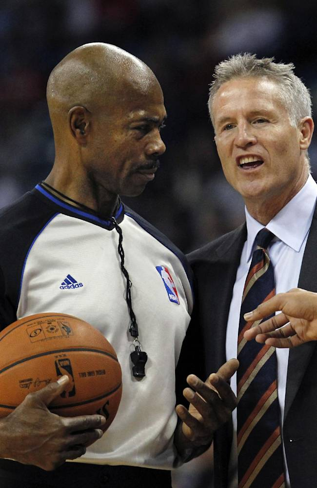 Philadelphia 76ers head coach Brett Brown challenges a call by the official in the first half of an NBA basketball game against the New Orleans Pelicans in New Orleans, Saturday, Nov. 16, 2013