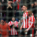 Sunderland's Connor Wickham, left, celebrates his goal with Jermain Defoe, right, during their English Premier League soccer match between Sunderland and Burnley at the Stadium of Light, Sunderland, England, Saturday, Jan. 31, 2015