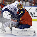 Florida Panthers goalie Roberto Luongo (1) collides with Toronto Maple Leafs left wing Mason Raymond who attempted a shot on the goal in the first period of an NHL hockey game on Thursday, April 10, 2014, in Sunrise, Fla The Associated Press