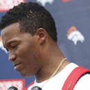 FILE - In this May 29, 2014 file photo, Denver Broncos wide receiver Demaryius Thomas talks to reporters after players took part in the team's NFL football minicamp at the Broncos' headquarters in Englewood, Colo. Thomas will miss the first few days of the Broncos' training camp to attend the funeral of the grandmother who helped raise him in Georgia. Thomas attended the Broncos' team meeting Wednesday, July 23, 2014, a day after his grandmother died, and received permission from coach John Fox to leave for a few days. (AP Photo/David Zalubowski, File)