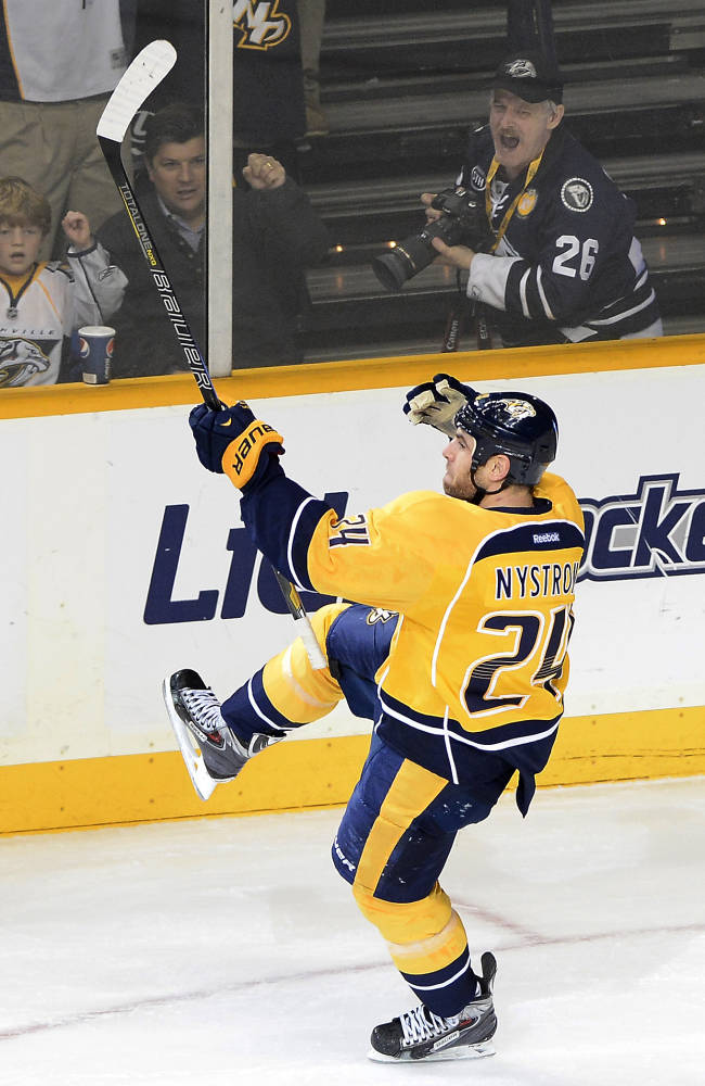 Nashville Predators forward Eric Nystrom celebrates after scoring on a penalty shot against Minnesota Wild in the first period of an NHL hockey game on Tuesday, Oct. 8, 2013, in Nashville, Tenn