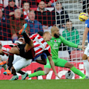 Sunderland's Wes Brown, center, has an unsuccessful shot towards goal past Everton's captain Phil Jagielka, right, during their English Premier League soccer match at the Stadium of Light, Sunderland, England, Sunday, Nov. 9, 2014