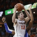Virginia guard Joe Harris (12) goes up for a shot in front of Duke forward Josh Hairston (15) during the second half of an NCAA college basketball game in Charlottesville, Va., Thursday, Feb. 28, 2013. Harris had 36 points as Virginia won 73-68. (AP Photo/Steve Helber)