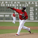 Boston Red Sox pitcher Rubby De La Rosa warms up before an exhibition baseball game against Boston College, Thursday, Feb. 27, 2014, in Fort Myers, Fla The Associated Press