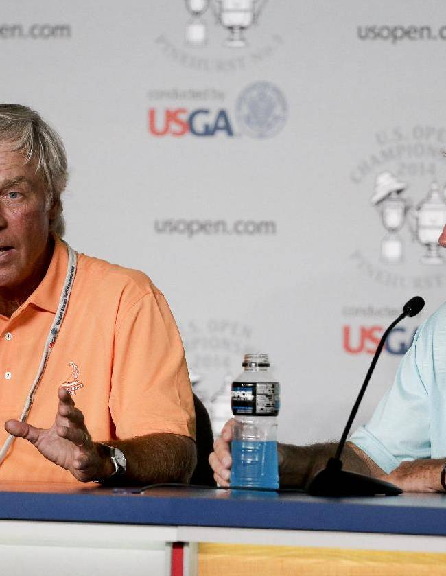 Former player Ben Crenshaw, left, and course designer Bill Coore talk about heir restoration of Pinehurst #2 during a news conference for the U.S. Open golf tournament in Pinehurst, N.C., Tuesday, June 10, 2014. The tournament starts Thursday