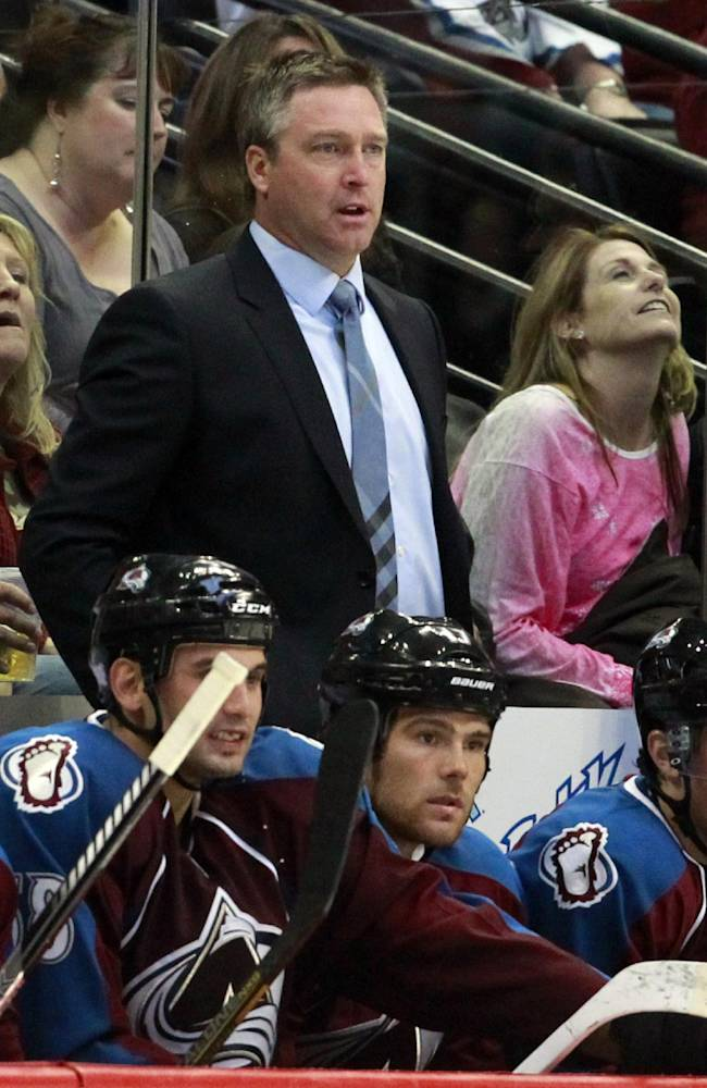 Colorado Avalanche head coach Patrick Roy, top center, directs his team against the Anaheim Ducks in the second period of an NHL hockey game in Denver, Wednesday, Oct. 2, 2013