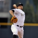 Colorado Rockies starting pitcher Jorge De La Rosa throws against the San Francisco Giants during the first inning of a baseball game on Friday, May 17, 2013, in Denver. (AP Photo/Jack Dempsey)
