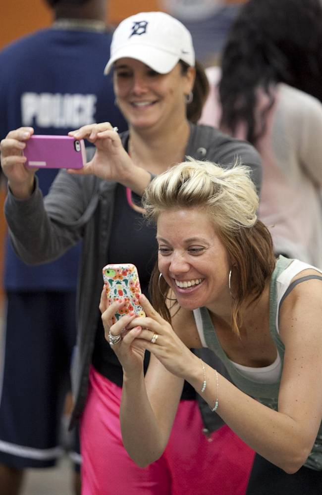 Sonya Kihn, left, and Amber Decker take pictures during Draymond Green's basketball camp at MVP Fieldhouse in Grand Rapids, Mich., Wednesday, June 25, 2014. Green plays for the Golden State Warriors NBA team and is a former Michigan State player. Kihn is from Ionia and Decker is from Hudsonville. They both had children attending the camp