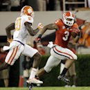 In this Aug. 30, 2014, file photo, Georgia's Todd Gurley, right, runs the ball past Clemson's Jayron Kearse in the second half of an NCAA college football game in Athens, Ga. Georgia will file a request with the NCAA for Gurley's eligibility to be reinsta