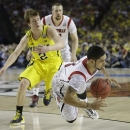 Louisville guard Peyton Siva (3) falls with the ball as Michigan guard Spike Albrecht (2) looks on during the second half of the NCAA Final Four tournament college basketball championship game Monday, April 8, 2013, in Atlanta. (AP Photo/John Bazemore)