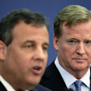 NFL commissioner Roger Goodell, right, listens to New Jersey Gov. Chris Christie speak at an NFL Foundation news conference Monday, Jan 27, 2014, in Newark, N.J. (AP Photo/Charlie Riedel)