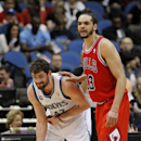 Minnesota Timberwolves forward Kevin Love, left, rubs his right elbow as he is guarded by Chicago Bulls center Joakim Noah during the first quarter of an NBA basketball game in Minneapolis, Wednesday, April 9, 2014. Love said he hyperextended his right el