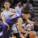 Phoenix Suns forward Gerald Green, front, drives past San Antonio Spurs guard Danny Green during the first half of an NBA basketball game on Friday, April 11, 2014, in San Antonio The Associated Press