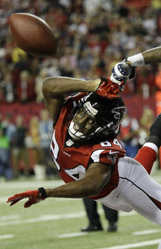 In this photo taken on Sunday, Oct 29, 2013m Falcons wide receiver Roddy White (84) can't reach a pass during the second half of an NFL football game against the New England Patriots in Atlanta. White's streak of playing in 133 consecutive regular-season games will end, as he will miss a game for the first time in nine seasons after injuring his hamstring. The four-time Pro Bowl selection was one of three starters listed as out on Friday's injury report