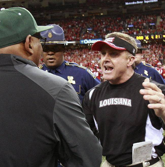 Louisiana-Lafayette head coach Mark Hudspeth, talks with Tulane head coach Curtis Johnson at the end of the New Orleans Bowl NCAA college football game, in New Orleans, Saturday, Dec. 21, 2013. Louisiana-Lafayette defeated Tulane 24-21