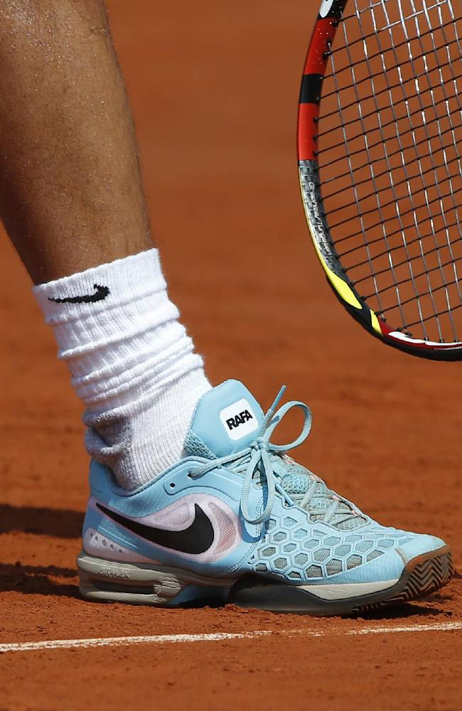 Spain's Rafael Nadal prepares to serve to Serbia's Novak Djokovic during the final match of  the French Open tennis tournament at the Roland Garros stadium, in Paris, France, Sunday, June 8, 2014