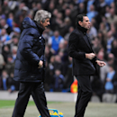 Sunderland's manager Gustavo Poyet, right, reacts after his side scored a second goal during the English Premier League soccer match between Manchester City and Sunderland at The Etihad Stadium, Manchester, England, Wednesday, April 16, 2014