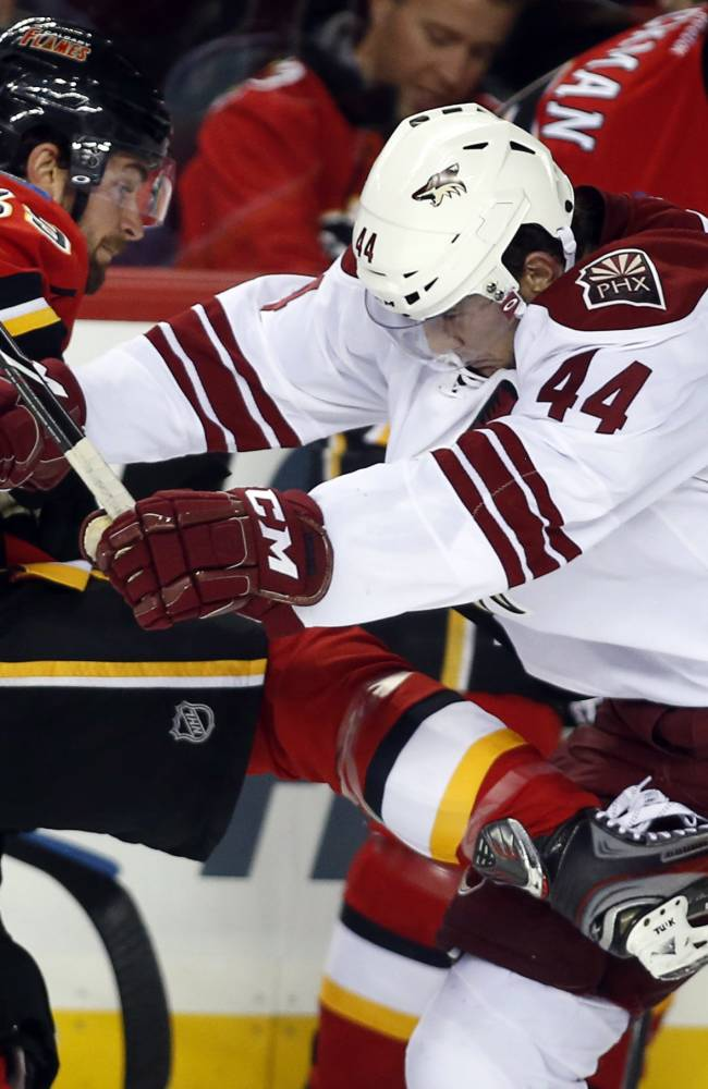 Coyotes slip past Flames in OT