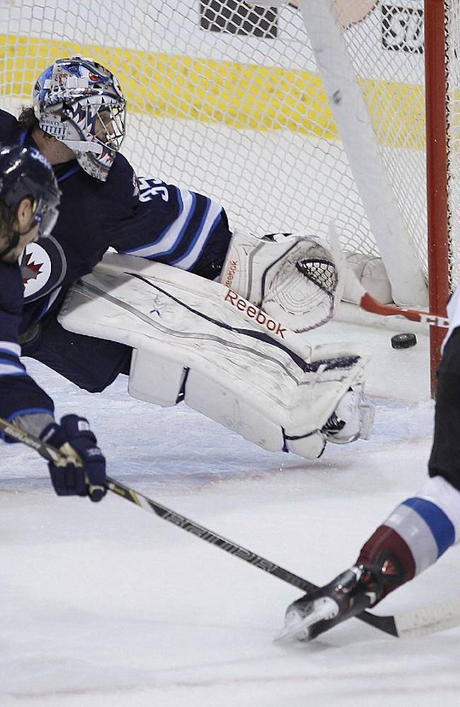 Colorado Avalanche's Gabriel Landeskog (92) rips the puck past Winnipeg Jets' goaltender Al Montoya (35) for a goal as Jets' Keaton Ellerby (7) defends during the first period of an NHL hockey game Wednesday, March 19, 2014, in Winnipeg, Manitoba