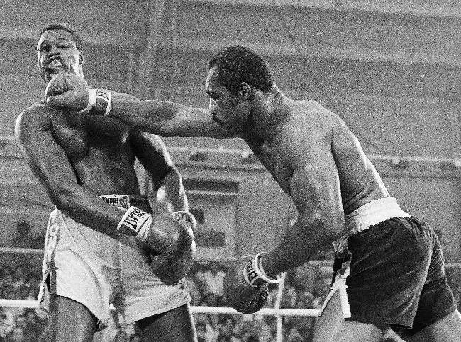 In this June 9, 1978, file photo, Ken Norton, left, and Larry Holmes battle for the WBC heavyweight championship at Caesars Palace in Las Vegas. Holmes won the bout in a 15-round split decision. Norton passed away Wednesday, Sept. 18, 2013, at a Las Vegas care facility, his son said. Norton was 70. Norton had been in poor health for the last several years after suffering a series of strokes, a friend of his said. Gene Kilroy, who was Ali's former business manager, says he's sure Norton is
