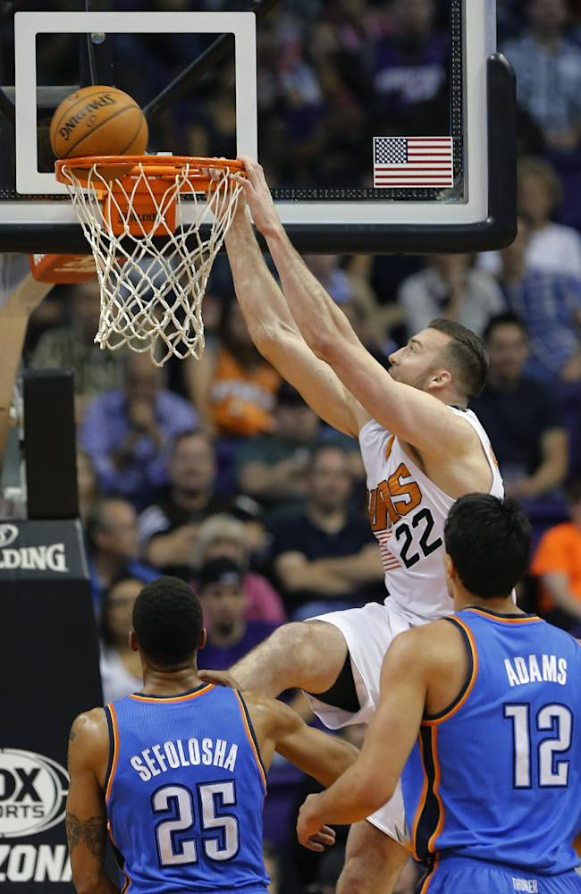 Phoenix Suns' Miles Plumlee (22) can't finish the dunk as Oklahoma Thunder's Thabo Sefolosha (25), of Switzerland, and Steven Adams (12) look on during the first half of an NBA preseason basketball game, Tuesday, Oct. 22, 2013, in Phoenix