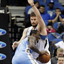 Denver Nuggets's J.J. Hickson, left, drives into Minnesota Timberwolves' Kevin Love in the first quarter of an NBA basketball game Wednesday, Feb. 12, 2014, in Minneapolis The Associated Press