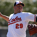 Baltimore Orioles relief pitcher Tommy Hunter throws in the fourth inning of an exhibition spring training baseball game against the Boston Red Sox in Sarasota, Fla.,Saturday, March 8, 2014 The Associated Press