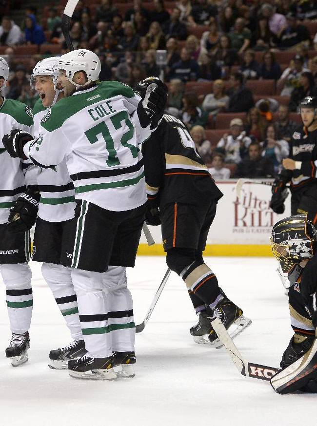 Dallas Stars center Shawn Horcoff, second from left, celebrates his goal with center Tyler Seguin, left, and right wing Erik Cole, second from right, as Anaheim Ducks goalie Jonas Hiller looks on during the first period of their NHL hockey game, Sunday, Oct. 20, 2013, in Anaheim, Calif