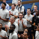 United States basketball head coach Mike Krzyzewski, center, and team members applaud for cadets running an indoor obstacle course at the U.S. Military Academy on Monday, Aug. 18, 2014, in West Point, N.Y. Krzyzewski is a 1969 graduate of the academy. (AP Photo/Mike Groll)